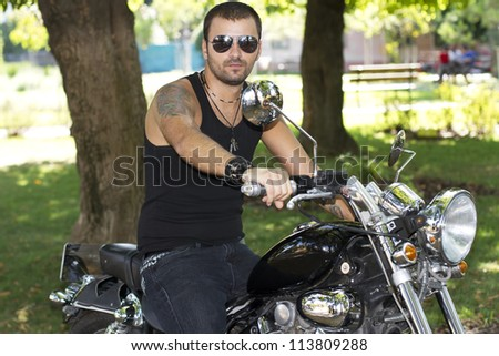 Rebel motorcycle rider on a chopper - stock photo
