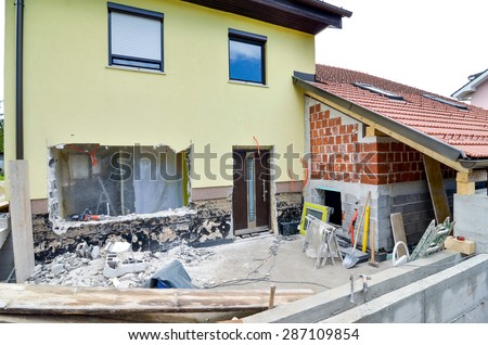 Rebuilding a family house and adding an  extension, opening walls and making a new terrace. Construction tools - stock photo