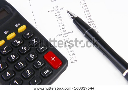 receipt calculator and pen - stock photo