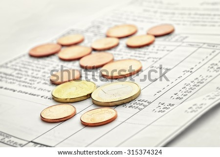 Receipt from shop and change coins - stock photo