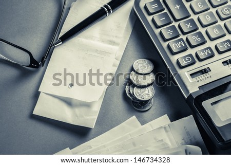 Receipts and coins for financial concept - stock photo
