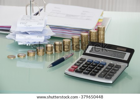Receipts In Paper Nail With Calculator And Money On Desk - stock photo