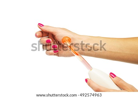 Receiving electric darsonval body and hand massage procedure isolated on white, Medical Spa treatment, Professional cosmetologist undergoing darsonvalization on skin, body care