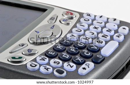 Recent model combination cell phone/PDA keypad closeup isolated on white