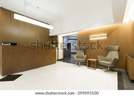 Reception area with wooden reception desk