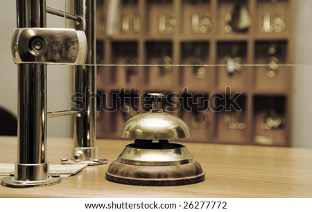 reception bell and keys cell on a background