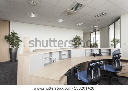 Reception desk in a modern office, interior - stock photo