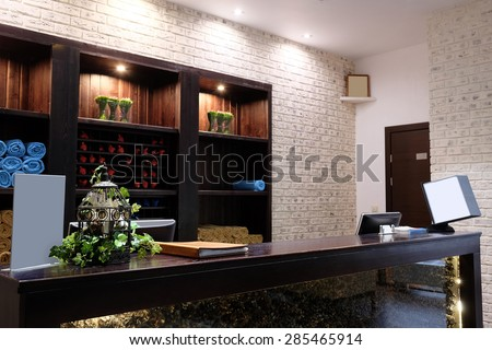 Reception desk in a spa salon - stock photo