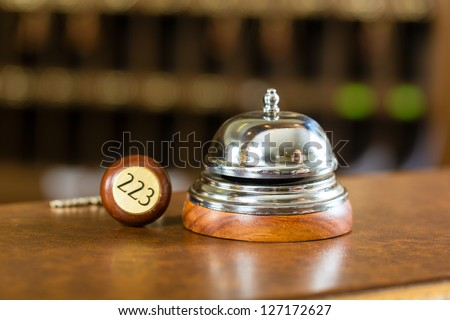 Reception - Hotel bell and key lying on the desk