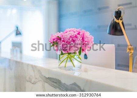 Reception Interior with beautiful pink flowers in vase - stock photo