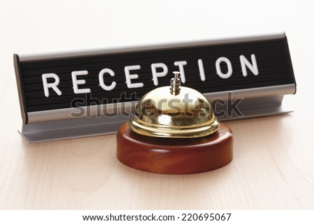 Reception sign with service bell on desk