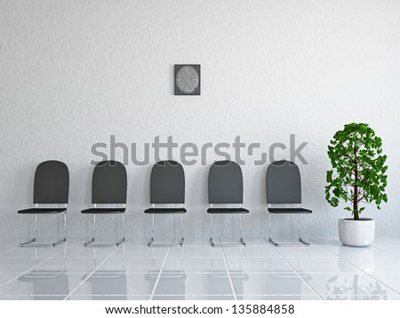 Reception with leather chairs near a wall - stock photo