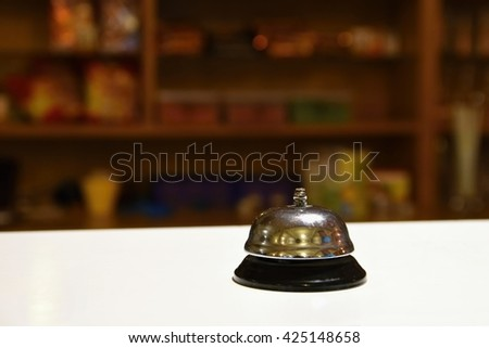 Receptionist bell. Blurred background reception or restaurant. - stock photo