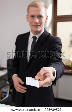 Receptionist working at the hotel giving calling card