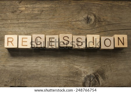 recession text on a wooden background - stock photo