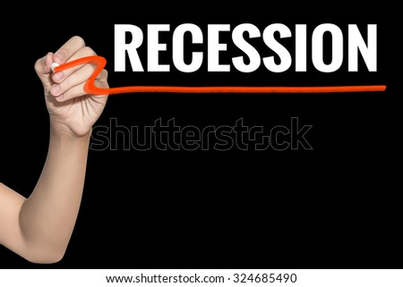 Recession word write on black background by woman hand holding highlighter pen - stock photo