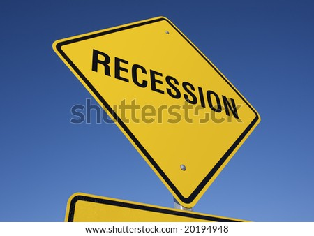 Recession Yellow Road Sign against a Deep Blue Sky - stock photo