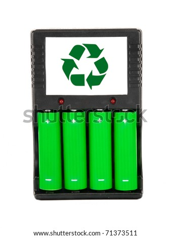 Rechargeable green batteries with black charger on white - stock photo