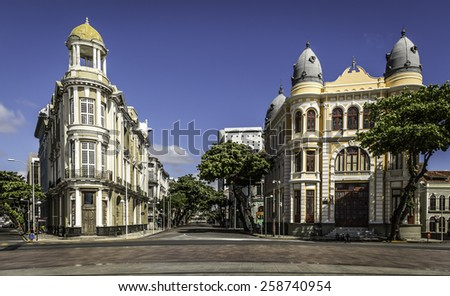 RECIFE, BRAZIL - APRIL 12, 2014: View of Recife in PE, Brazil showcasing the architecture of its landmark Marco Zero on a sunny summer day with locals and tourists passing by on April 12, 2014. - stock photo