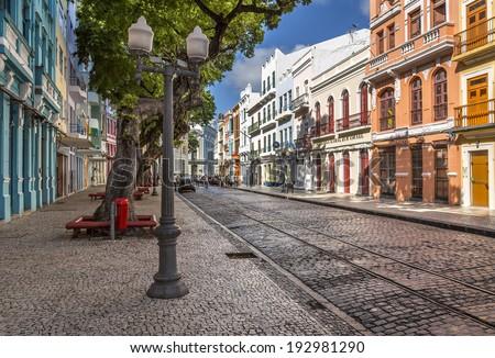RECIFE, BRAZIL - APRIL 15: View of the historic architecture of Bom Jesus Street in Recife Antigo, Pernambuco, Brazil where the local carnival festival takes place on April 15, 2014. - stock photo