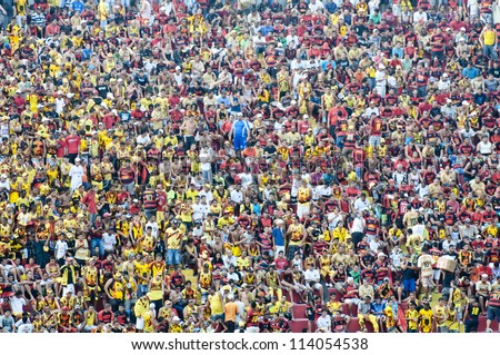 RECIFE, BRAZIL-CIRCA OCT 2010: Fans of the Sport Club do Recife await the start of the match against the rival team. circa October 2010 in Recife. - stock photo