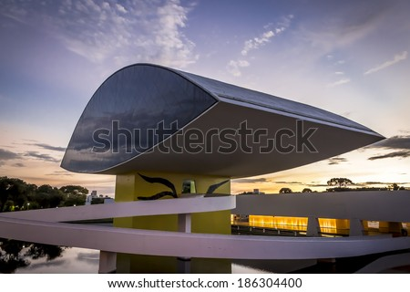 RECIFE, BRAZIL - MARCH 30: the modern architecture of Oscar Niemeyer Museum in Curitiba, Parana, Brazil at sunset with its eye shaped monument on March 30, 2014. - stock photo