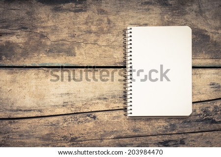 Recipe book on textured wood background. Vintage style image - stock photo
