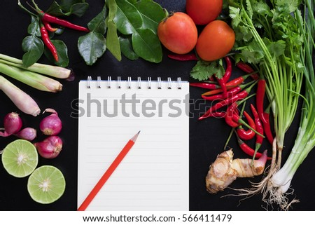 Recipe book fresh herbs south asia stock photo 566411479 recipe book with fresh herbs south asia and spices on black background concept thai forumfinder Images