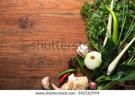 recipe book with fresh herbs south asia and spices on wooden background, thai food,asian foods.