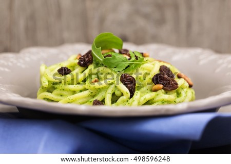 recipe of troccoli pasta with rocket pesto, roasted pine seed and raisins