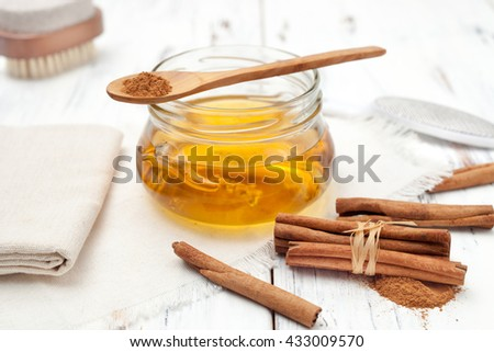 recipes for home-made cosmetics made from honey and cinnamon - stock photo