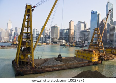 Reclaiming more precious land on Hong Kong Island - stock photo
