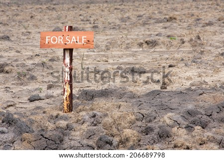 reclamation land area with wooden sign pole for sale - stock photo