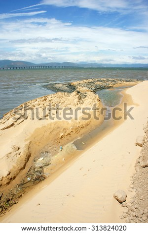 Reclamation project at Quy Nhon, Binh Dinh, Viet Nam, fill up sand on water to make construction plan, try to change nature for human profit, fill soil at seaside