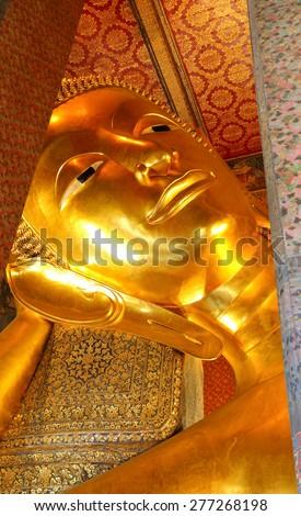 Reclining Buddha at Wat Pho, Bangkok, Thailand. - stock photo