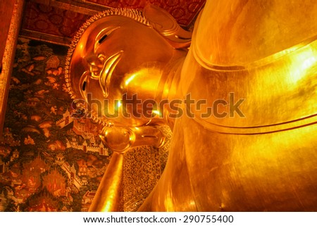 Reclining Buddha at Wat Pho, Bangkok, Thailand. - stock photo