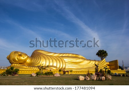 Reclining Buddha gold statue face at Bangkok, Thailand - stock photo