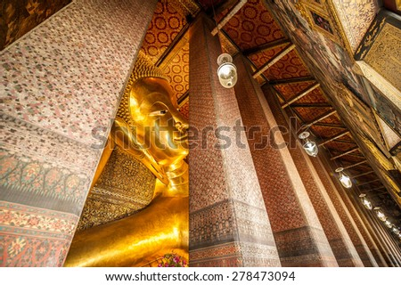 Reclining Buddha gold statue face. Wat Pho, Bangkok, Thailand - stock photo