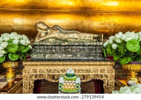 Reclining Buddha gold statue face. Wat Pho, Bangkok, Thailand - stock photo