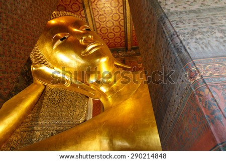 Reclining Buddha gold statue face. Wat Pho, Bangkok, Thailand.  this is public temple where people can come to take picture.