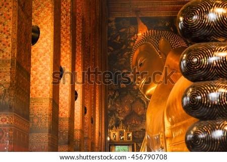 Reclining Buddha gold statue of Wat Pho, Bangkok, Thailand - stock photo