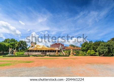 Reclining buddha in Wat Phra Mongkol Kiri, Phrae Province, Thailand - stock photo