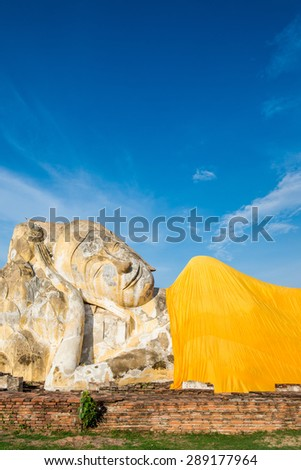 Reclining Buddha of Wat Lokaya Sutha in Ayutthaya, Thailand, public temple where people can come to take picture - stock photo