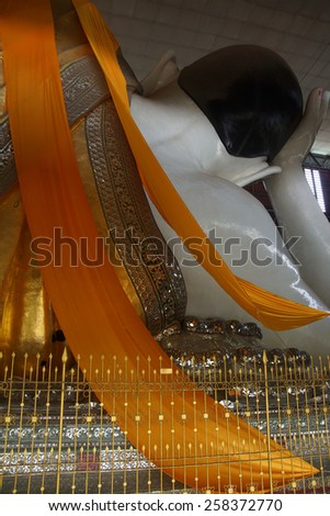 Reclining buddha, seen from behind,Chauk Htat Gyi Pagoda, Yangon (Rangoon),  Myanmar (Burma) - stock photo