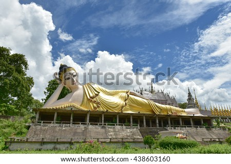 Reclining Buddha statue Burmese painted white and decorated with ornaments. of Wat Phra That Suthon Mongkhon Khiri in Phrae, Thailand - stock photo
