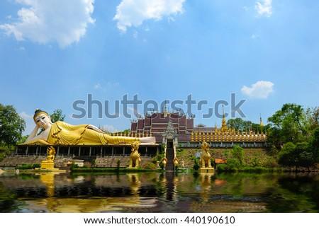 Reclining Buddha statue Burmese  ,  Thailand temple - stock photo