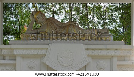 reclining buddha statue, in mendut buddhist monastery - stock photo