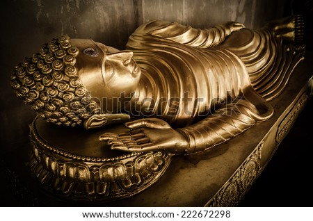 Reclining Buddha statue in Wat Phra That Hariphunchai temple , Thailand