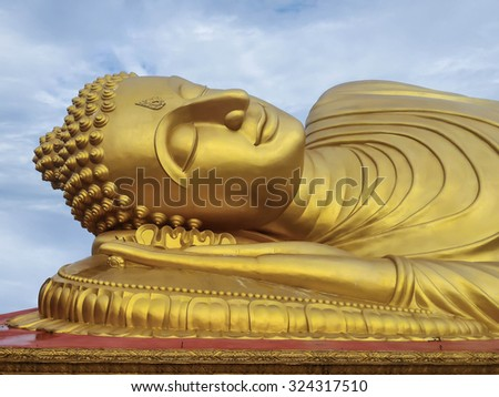 Reclining Golden Buddha at Songkhla province, south of Thailand. - stock photo