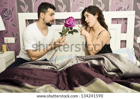 Reconciliation in vintage bedroom. Couple issues. - stock photo